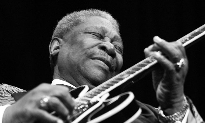 Blues legend B.B. King performs on Feb. 17, 2002, at the House of Blues in Las Vegas, Nev. Work as a radio DJ helped King get started as a performer. (Scott Harrison/Getty Images