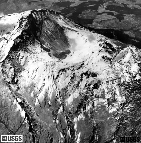 The crater area dropped in relation to the summit, and the growing bulge (right)  shows pronounced fracturing because of its increased expansion, prior to the eruption of Mount St. Helens. (USGS)