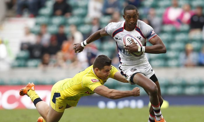 Australia's Greg Jeloudev (L) misses a tackle on US's Perry Baker during the London Sevens rugby union cup final match between USA and Australia, part of the IRB Sevens World Series, at Twickenham Stadium in London on May 17, 2015. (Justin Tallis/AFP/Getty Images)