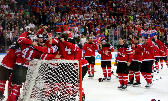 Team Canada celebrates after crushing Russia in the IIHF World Championship gold medal game at O2 Arena on May 17, 2015 in Prague, Czech Republic. (Martin Rose/Bongarts/Getty Images)