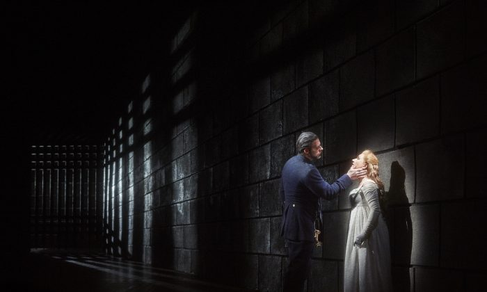 "John Relyea as Duke Bluebeard and Ekaterina Gubanova as Judith in the Canadian Opera Company's 2015 production of ""Bluebeard's Castle."" (Michael Cooper)"