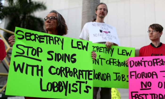 Union members and community activists protest outside the Miami Dade College where the Greater Miami Chamber of Commerce and the college were hosting a moderated conversation with U.S. Secretary of the Treasury Jacob Lew on March 20, in Miami, Fla. Skepticism about the Trans-Pacific Partnership has recently grown. (Joe Raedle/Getty Images)