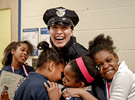 Community Policing Officer Jackelyn Burgos with Cleveland Public School children at conclusion of G.R.E.A.T. program. (Courtesy of Cuyahoga Metropolitan Housing Police Department)