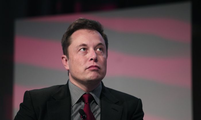 Elon Musk, co-founder and CEO of Tesla Motors, speaks at the 2015 Automotive News World Congress in Detroit, Michigan, January 13, 2015. Tesla faces shareholder lawsuits that may delay its proposed merger with SolarCity. (Bill Pugliano/Getty Images)