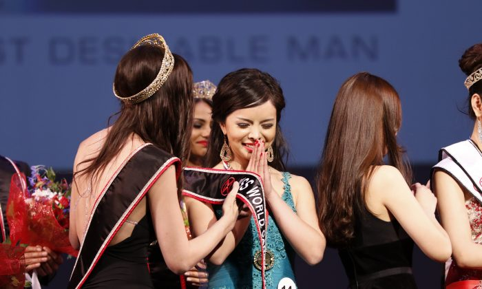 Anastasia Lin from Toronto was named Miss World Canada in a ceremony in Vancouver on May 16, 2015. Three days later, she learned that the family in China was being threatened by security forces because of her human rights advocacy work in Canada. (Andrew Chin)