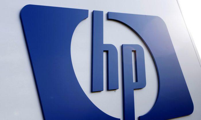 FILE - This Feb. 21, 2012 file photo shows a Hewlett Packard logo in Frisco, Texas. (AP Photo/LM Otero, File)