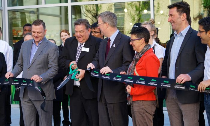 Preparing to cut the ribbon at the opening of Sobeys in downtown Ottawa on May 22, 2015, are from left to right: Ottawa Food Bank executive director Michael Maidment, store manager John Leblanc, Ottawa Mayor Jim Watson, councillor Catherine McKenney, MP Paul Dewar, and MPP Yasir Naqvi. (Pam McLennan/Epoch Times)