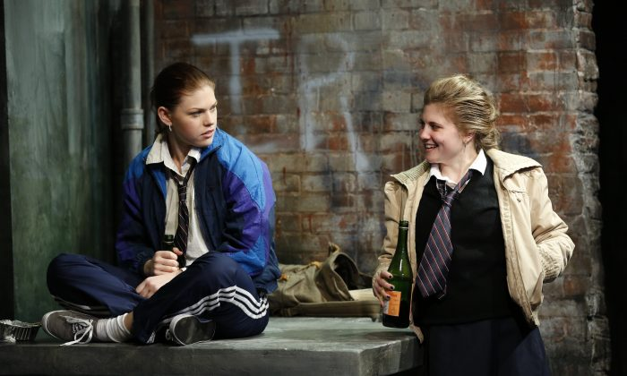 """(L–R) Anne Malloy (Kate Lydic) is having a rough time since her parents were innocent victims in war-torn Belfast, and her best friend Ciara (Arielle Hoffman) offers her little help, in """"The Belle of Belfast."""" (Carol Rosegg)"""