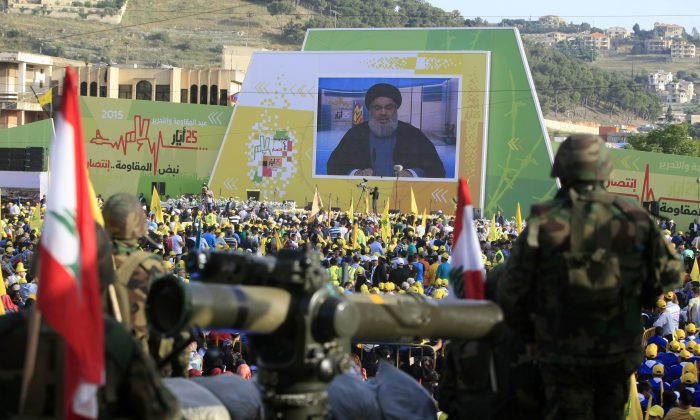 Hezbollah fighters stand guard as Hezbollah leader Sheikh Hassan Nasrallah (C) delivers a speech in a file photo (AP Photo/Mohammed Zaatari)