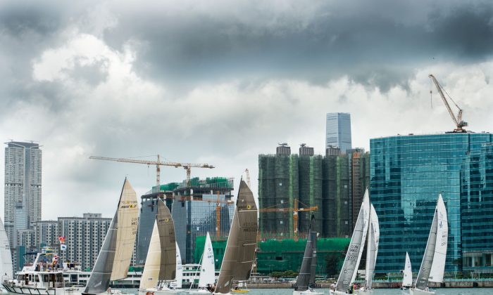 Sportsboats set off on Race-2 of the RHKYC Edmond de Rothschild Spring Regatta from Kowloon Bay on Sunday May 17, 2015. (Ike Li/Prezzimages)