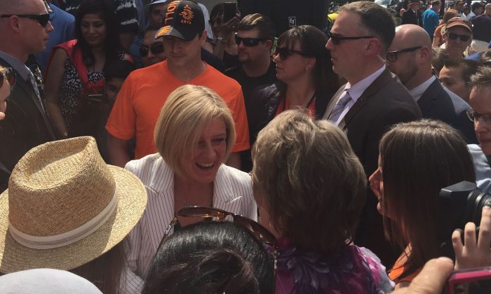 New Alberta Premier Rachel Notley (C) greets supporters at the Alberta Legislature Grounds on May 24, 2015, following the swearing-in ceremony of the new premier and her cabinet. (Omid Ghoreishi/Epoch Times)
