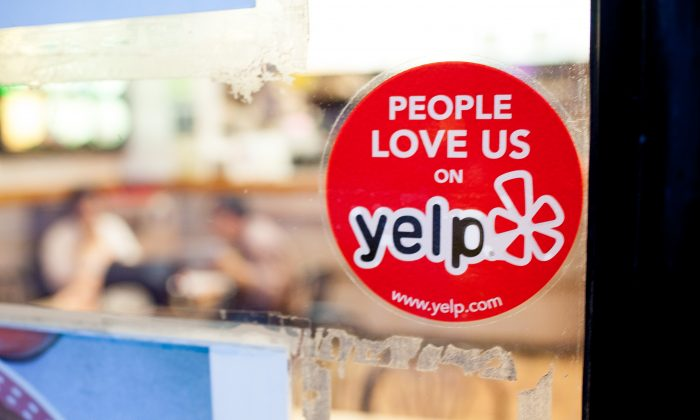 A Yelp sticker on a restaurant in the Chelsea neighborhood of Manhattan in this file photo. (Petr Svab/Epoch Times)