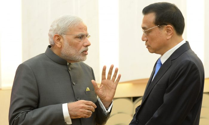 Indian Prime Minister Narendra Modi (L) talks with Chinese Premier Li Keqiang (R) after a press conference at the Great Hall of the People on May 15, in Beijing, China. Modi spoke more directly than Indian leaders often have when dealing with Beijing. (Kenzaburo Fukuhara - Pool/Getty Images)