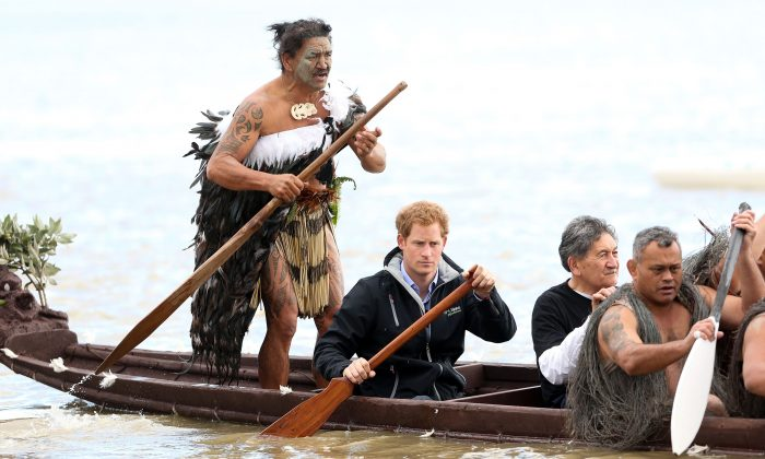 Ned Tapa and Prince Harry paddle a waka down the Whanganui River after a visit to Putiki Marae on May 14, 2015 in Wanganui, New Zealand. Prince Harry is in New Zealand from May 9 through to May 16 attending events in Wellington, Invercargill, Stewart Island, Christchurch, Linton, Whanganui and Auckland. (Hagen Hopkins/Getty Images)