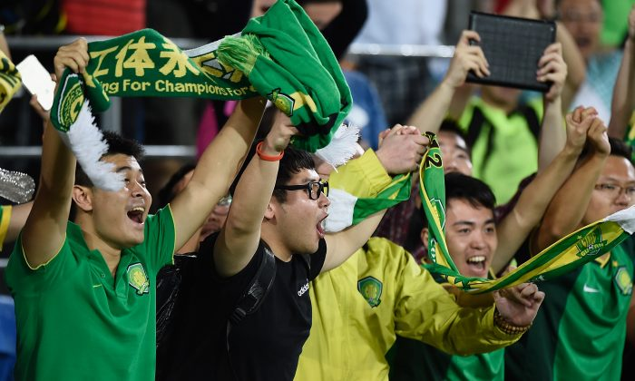 Fans of Beijing Guoan celebrate victory during the AFC Asian Champions League match between Brisbane Roar and Beijing Guoan at Cbus Super Stadium on February 25, 2015 on the Gold Coast, Australia. (Matt Roberts/Getty Images)