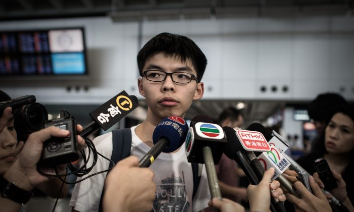 Hong Kong student activist Joshua Wong talks to the media at the international airport in Hong Kong on May 26, 2015. Wong was barred from entering Malaysia at Penang airport on May 26 where he was scheduled to attend forums on June 3, the eve of the 26th anniversary of the Tiananmen Square events in China. (Philippe Lopez/AFP/Getty Images)