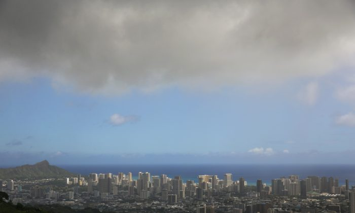 In this Aug. 7, 2014 photo clouds hang over Honolulu as Hurricane Iselle approaches. (AP Photo/Marco Garcia)