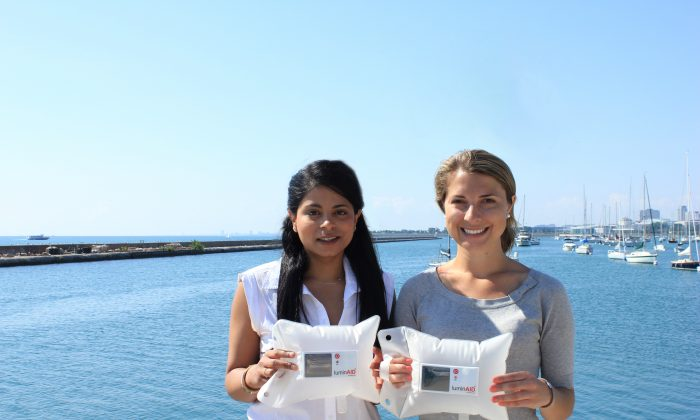 LuminAid co-founders Andrea Sreshta (L) and Anna Stork with their original solar inflatable light. (      )