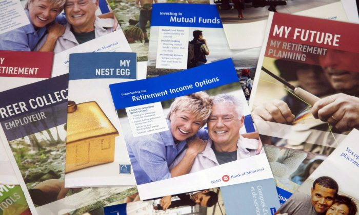 Brochures offering various retirement savings options. The Harper government says it's considering giving Canadians the option of voluntarily hiking their contributions to the Canada Pension Plan, which would help them boost their retirement savings. The Liberals want a mandatory expansion of the CPP. (The Canadian Press/Ryan Remiorz)