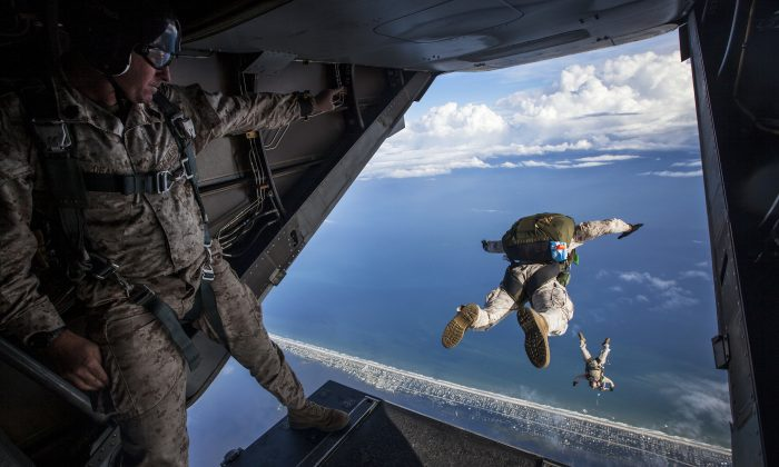 Force Reconnaissance Marines with the Maritime Raid Force, 24th Marine Expeditionary Unit perform a diving exit while conducting an initial High Altitude Low Opening jump out of an MV-22B Osprey at Marine Corps Auxiliary Landing Field Bogue Field, N.C., Aug. 11, 2014. Air support for the training was provided by the MEU's Aviation Combat Element, Marine Medium Tiltrotor Squadron 365 (Reinforced). The training took place as part of pre-deployment training in preparation for the 24th MEU's deployment at the end of the year. (U.S. Marine Corps photo by Cpl. Todd F. Michalek)