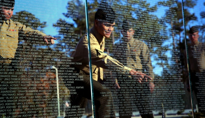 Marines with Alpha Battery, 2nd Low Altitude Air Defense Battalion point out names at the Onslow County Vietnam Veterans Memorial, Jacksonville, N.C., Dec. 18, 2014. (U.S. Marine Corps photo by Lance Cpl. Neysa Huertas Quinone/Released)