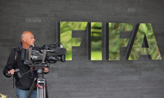 Preparing for scrutiny. Wednesday's FIFA press conference gets ready to roll. (Philipp Schmidli/Getty Images)