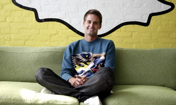 In this Thursday, Oct. 24, 2013, Snapchat CEO Evan Spiegel poses for photos, in Los Angeles.  (AP Photo/Jae C. Hong)