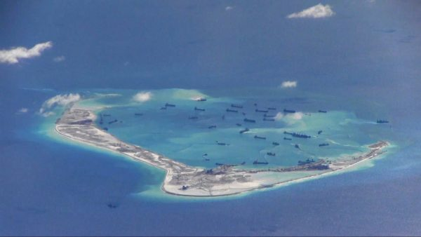 Chinese dredgers work on the construction of artificial islands on and around Michief Reef in the Spratly Islands of the South China Sea on May 2, 2015. (U.S. Navy)