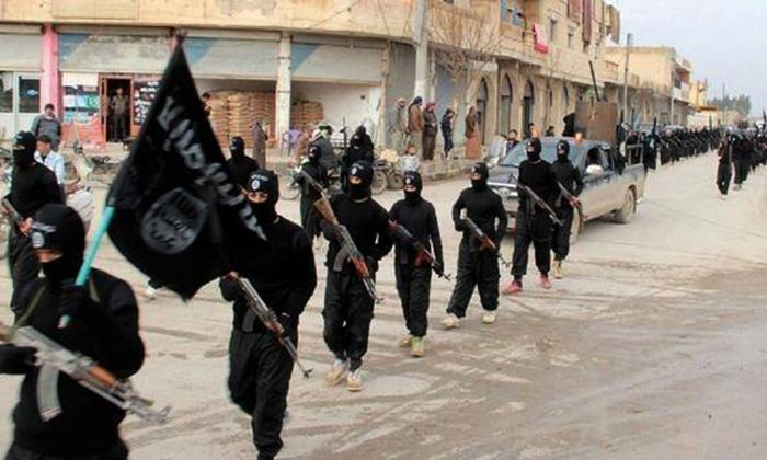 Islamic State militants march in Raqqa, Syria, on Jan. 14, 2014. (Militant Website via AP)