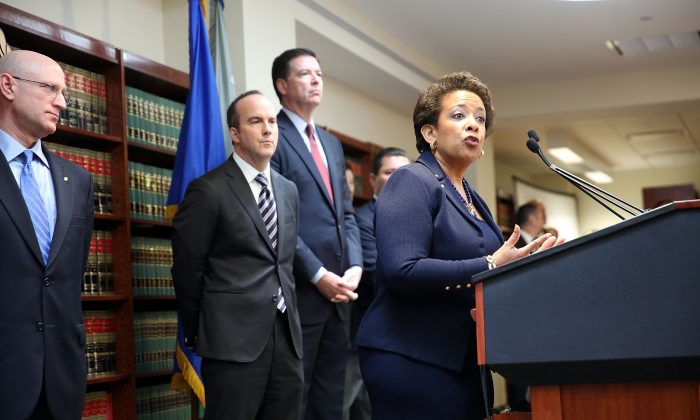 Attorney General Loretta Lynch speaks at the U.S. Attorneys Office of the Eastern District of New York in New York City following the early morning arrest of world soccer figures, including officials of FIFA, for racketeering, bribery, money laundering, and fraud, on May 27. (Spencer Platt/Getty Images)