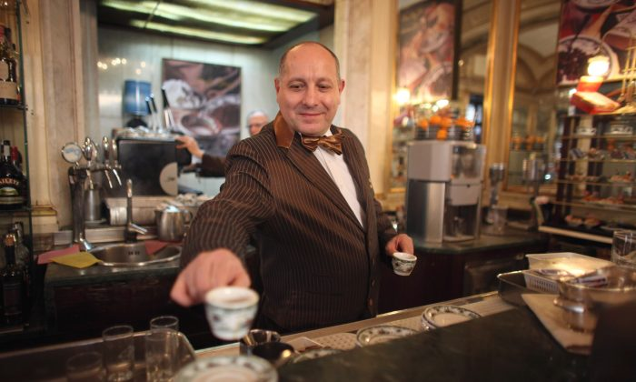 A barista serves coffee in Gran Caffe Gambrinus on November 16, 2011 in Naples, Italy. (Christopher Furlong/Getty Images)