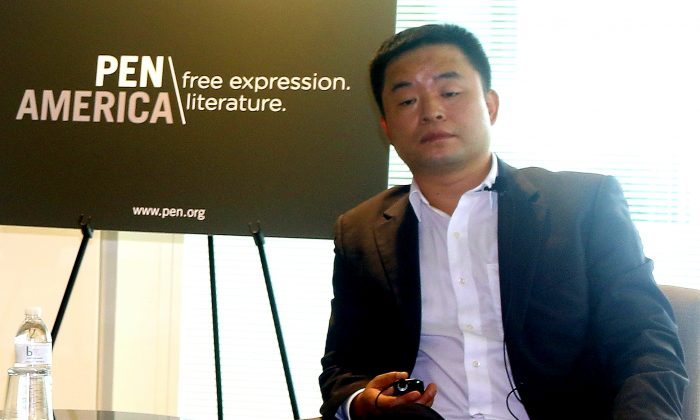 """Murong Xuecun, social critic, and one of China's first Internet-based writers, had about 8.5 million followers on Weibo, before censors shut down his accounts in May 2013. Murong Xuecun is the pen name for Hao Qun.  He spoke May 28 at Freedom House, on """"Culture and Control: The tightening grip of censorship in Xi's China."""" (Gary Feuerberg/ Epoch Times)"""