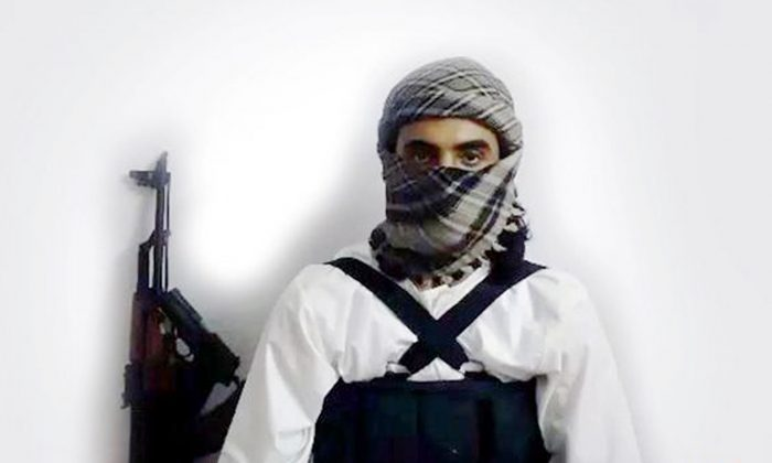 """This file image taken from a militant website associated with Islamic State extremists, posted Saturday, May 23, 2015, purports to show a suicide bomber,  with the Arabic bar below reading: """"Urgent: The heroic martyr Abu Amer al-Najdi, the attacker of the (Shiite) temple in Qatif"""",  which the Islamic State group's radio station claimed responsibility for. (Militant photo via AP)"""
