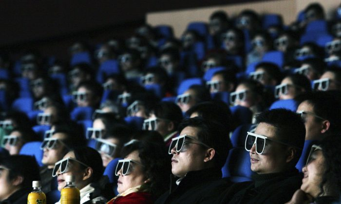 Audience members watch a movie through 3D glasses at a newly opened IMAX theatre on February 8, 2007 in Wuhan of Hubei Province, China.  IMAX plans to sell shares of its China unit in Hong Kong. (China Photos/Getty Images)