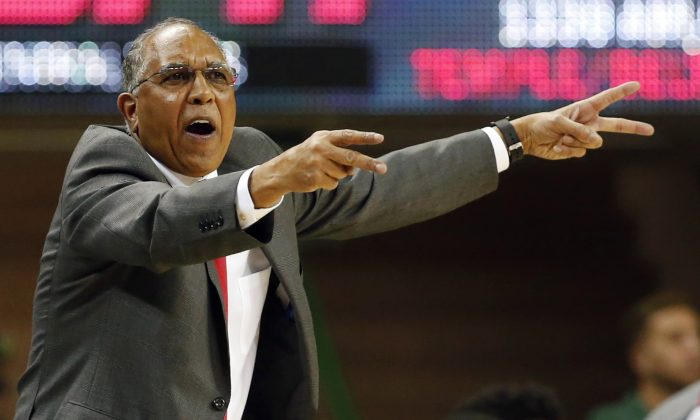 In this March 6, 2015, file photo, Texas Tech  head coach Tubby Smith points to his defense in the second half of an NCAA college basketball game against Baylor in Waco, Texas. (AP Photo/Jerry Larson, File)