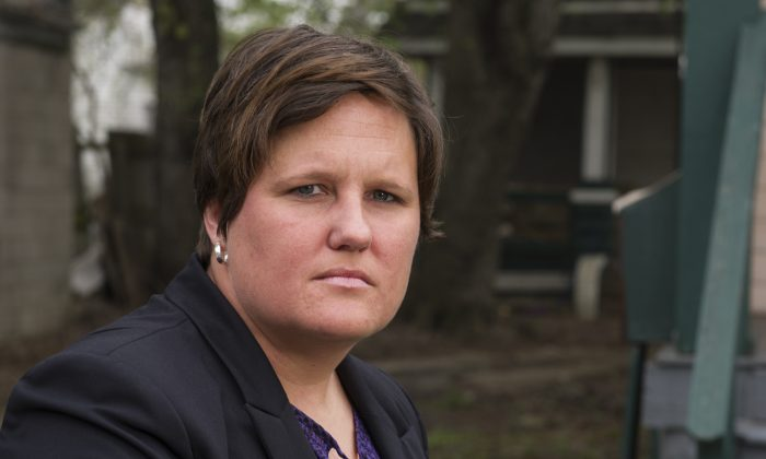 Stacey Fifer, a special agent for the Ohio Bureau of Criminal Investigation and a member of the Cuyahoga County Sexual Assault Task Force, stands in a south Cleveland neighborhood on Tuesday, May 5, 2015. (AP Photo/Phil Long)