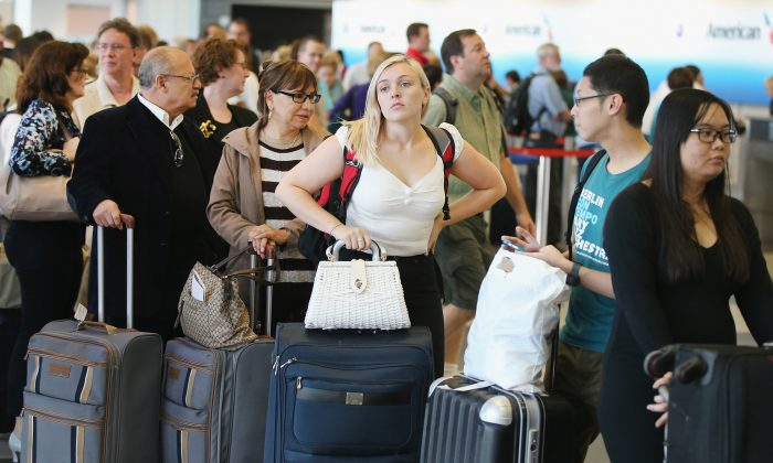 Passengers wait in line at the O'Hare International Airport in Chicago on on Sept. 26, 2014. (Scott Olson/Getty Images)