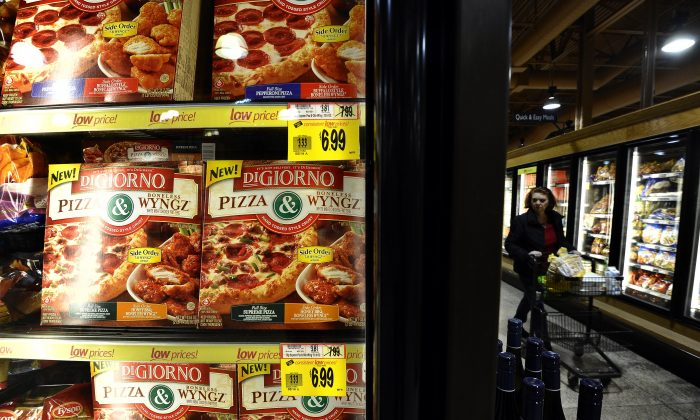 A woman shops in the frozen foods aisle at a Wegmans supermarket in Fairfax, Virginia, on February 24, 2011. (Photo credit should read Jewel Samad/AFP/Getty Images)