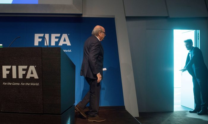 FIFA President Sepp Blatter leaves after a press conference at the headquarters of the world's football governing body in Zurich on June 2, 2015. (Valeriano Di Domenico/AFP/Getty Images)
