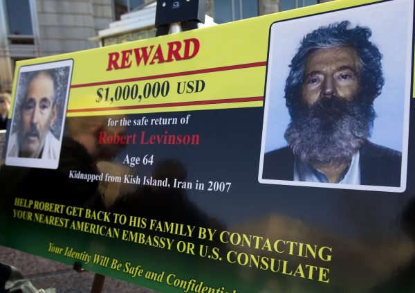 An FBI poster showing a composite image of former FBI agent Robert Levinson, right, of how he would look like now after five years in captivity, and an image, left, taken from the video, released by his kidnappers, Tuesday, March 6, 2012, in Washington during a news conference. The FBI announced a reward of up to $1million for information leading directly to the safe location, recovery and return of Robert A. Levinson, a U.S. citizen and former FBI Special Agent who disappeared from Kish Island, Iran, five years ago. (AP Photo/Manuel Balce Ceneta)