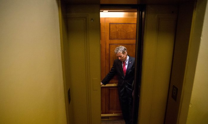 Republican presidential candidate, Sen. Rand Paul, R-Ky. departs in an elevator after speaking at a news conference on Capitol Hill in Washington, Tuesday, June 2, 2015, calling for the 28 classified pages of the 9-11 report to be declassified. (AP Photo/Andrew Harnik)