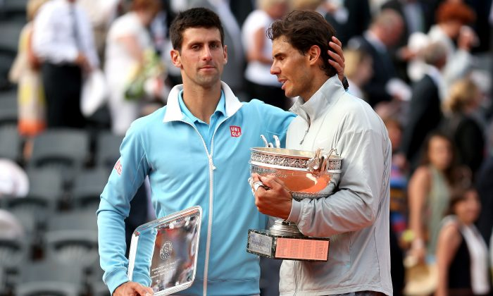 Rafael Nadal (R) has beaten Novak Djokovic all six times they've met at Roland Garros. (Matthew Stockman/Getty Images)