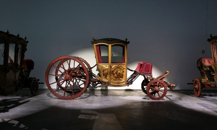 In this May 14, 2015 photo, an 18th Century coupe coach, ordered by Portuguese King Joao V for his sons, is displayed at the new building of the National Coach Museum in Lisbon. (AP Photo/Armando Franca)