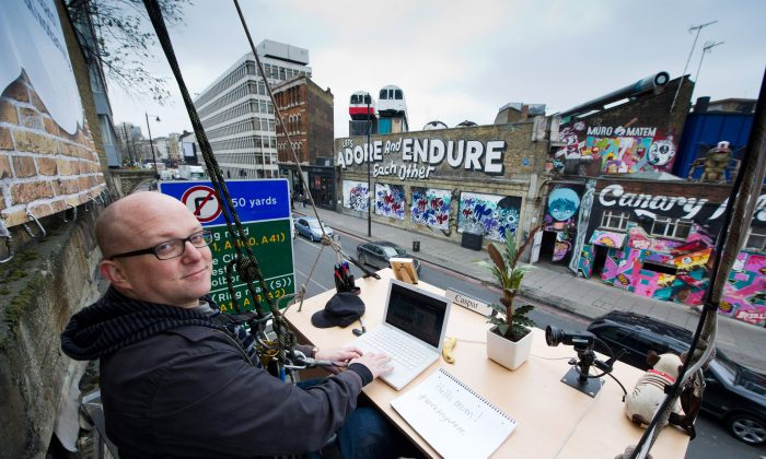 An office worker works at a desk suspended from the outside of a building at Peter The Pleater in London, England. Taking flexible working to new heights, O2 is proving you really can work anywhere.  (Ian Gavan/Getty Images for O2)