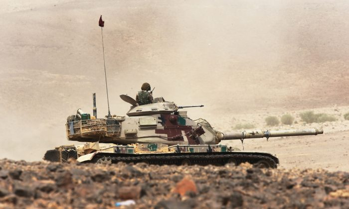 A tank participates in the final counter attack during joint military exercises by Jordan and 18 other nations including the U.S. as part of the annual Eager Lion on May 18, 2015 in the southeast desert of Wadi Shadiyah, Jordan. (Jordan Pix/ Getty Images)
