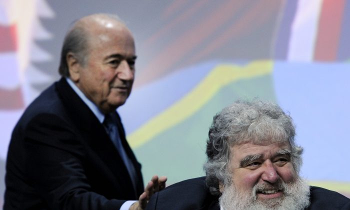 FIFA President Sepp Blatter (L) taps shoulders of the general-secretary of the Caribbean, North and Central American (CONCACAF) Chuck Blazer, on June 1, 2011 at the start of the 61st FIFA congress at the Zurich Hallenstadion in Oerlikon near Zurich. (Fabrice Cofrini/AFP/Getty Images)