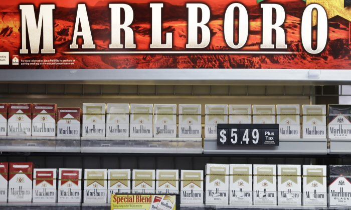 Marlboro Gold and other Marlboro varieties of cigarettes are displayed in a Little Rock, Ark., store Wednesday, Oct. 23, 2013. (AP Photo/Danny Johnston)