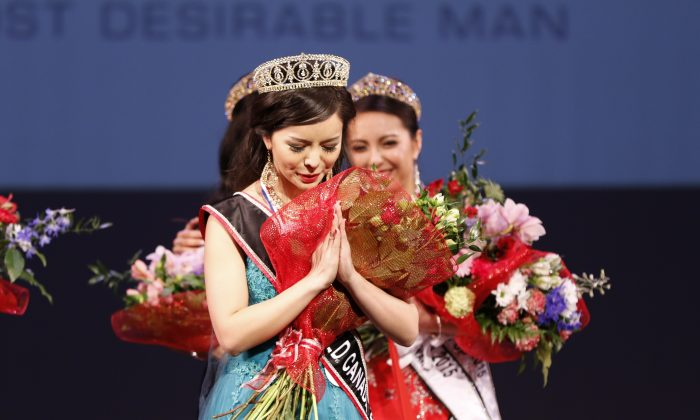 Anastasia Lin is crowned Miss World Canada at a ceremony in Vancouver on May 16, 2015. Lin said the threats made to silence her human rights advocacy are common to many Chinese Canadians. (Andrew Chin)