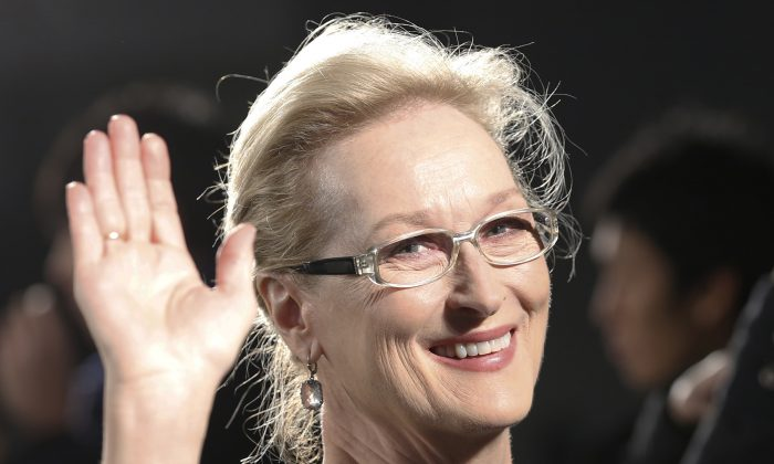 "Meryl Streep waves to photographers during the Japan premiere of ""Into the Woods"" in Tokyo. (AP/Shizuo Kambayashi)"