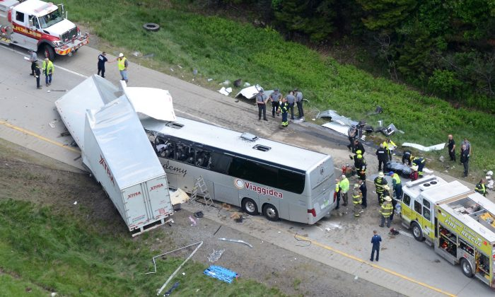 Authorities investigate the scene of a fatal collision between a tractor-trailer and a tour bus on Interstate 380 near Mount Pocono, Pa., Wednesday, June 3, 2015. (AP/David Kidwell)